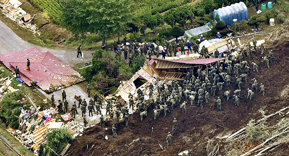 Members of the Japan Self-Defense Forces (JSDF) search for survivors from a house damaged by a landslide caused by an earthquake in Atsuma town, Hokkaido, northern Japan, in this photo taken by Kyodo September 7, 2018