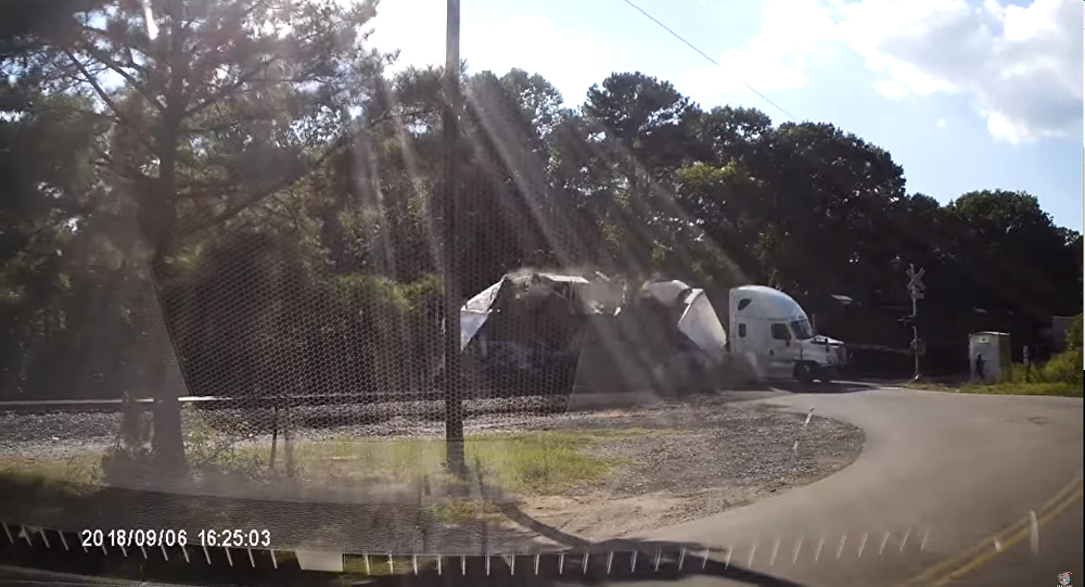 A tractor trailer is smashed in two by a CSX train on Thursday, September 6, 2018, in Chester, Virginia