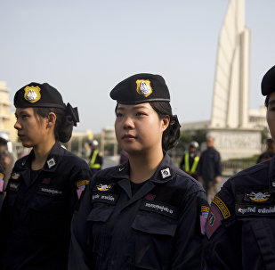 Thailand police women provide security during a protest near the democracy monument in Bangkok, Thailand on Saturday, Feb. 10, 2018