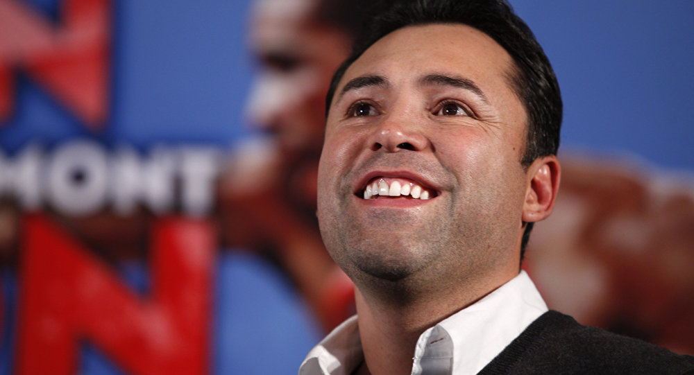 Boxing promoter Oscar De La Hoya looks on during the the weigh-in for the upcoming title fight between Amir Kahn and Lamont Peterson, in Washington, on Friday, Dec. 9, 2011