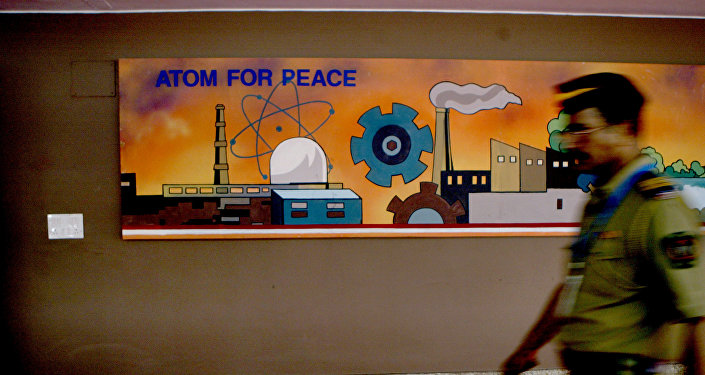A policeman walks past a mural at the Bhabha Atomic Research Centre (BARC) Training School where Prime Minister Manmohan Singh is visiting, in Mumbai, India, Friday, Aug. 31, 2007.