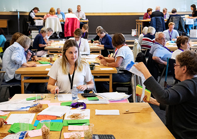 Election officials count ballot papers at a tally centre in Malmo, Sweden September 11, 2018