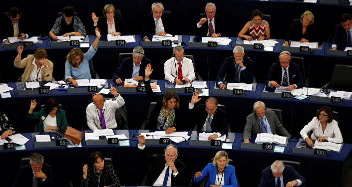 Members of the European Parliament take part in a vote on the situation in Hungary during a voting session at the European Parliament in Strasbourg, France, September 12, 2018