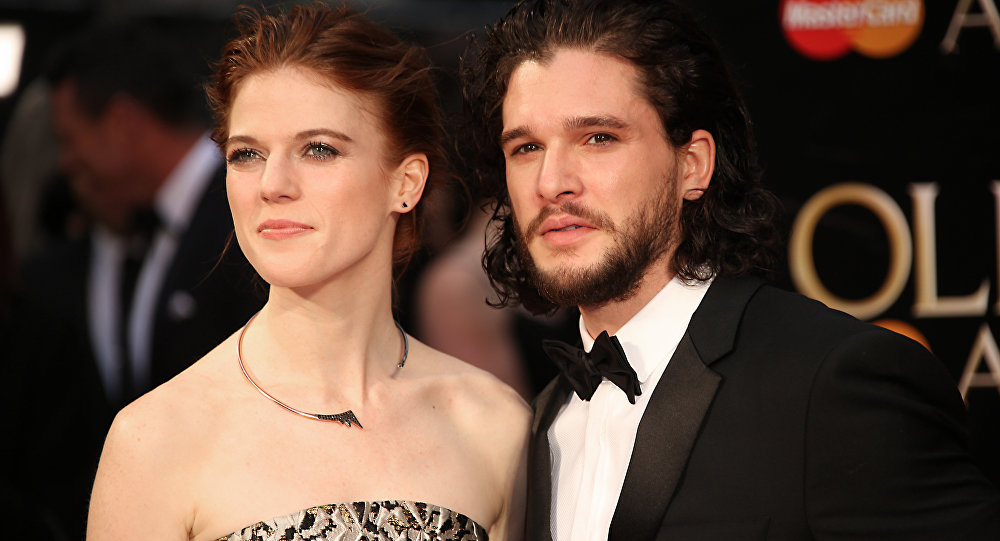 Actors Rose Leslie, left, and Kit Harrington pose for photographers upon arrival at the Olivier Awards in London, Sunday, April 3, 2016.