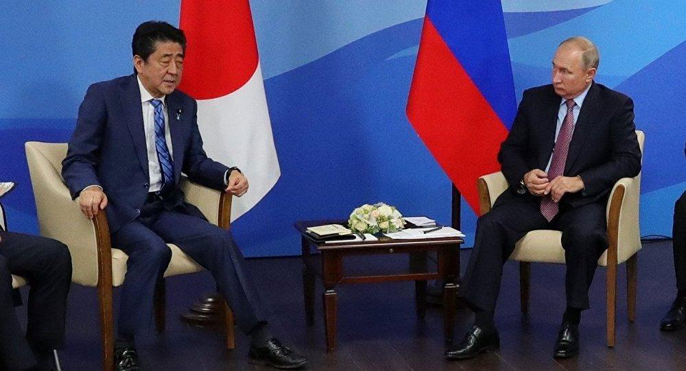 September 10, 2018. Russian President Vladimir Putin and Japanese Prime Minister Shinzō Abe, center left, during a meeting in Vladivostok