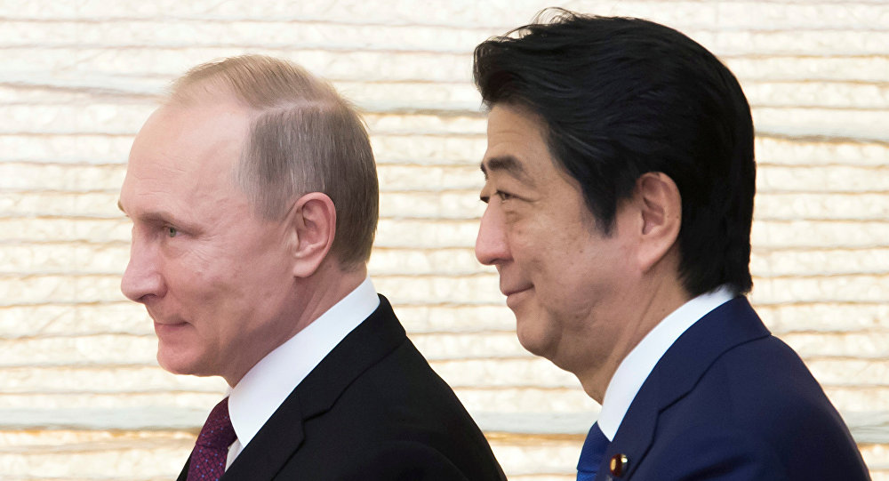Vladimir Putin, Russia's president, and Shinzo Abe, Japan's prime minister, arrive for a working lunch at the prime minister's official residence in Tokyo, Japan, on Friday, Dec. 16, 2016.