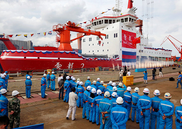 People attend the launch ceremony of China's first domestically built polar icebreaker Xuelong 2, or Snow Dragon 2, at a shipyard in Shanghai, China September 10, 2018.