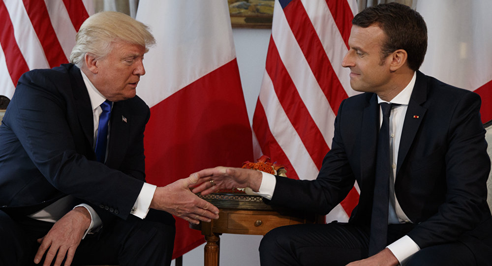 President Donald Trump shakes hands with French President Emmanuel Macron during a meeting at the U.S. Embassy, Thursday, May 25, 2017, in Brussels