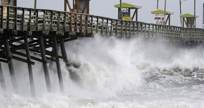 Waves from Hurricane Florence pound the Bogue Inlet Pier in Emerald Isle N.C., Thursday, Sept. 13, 2018.