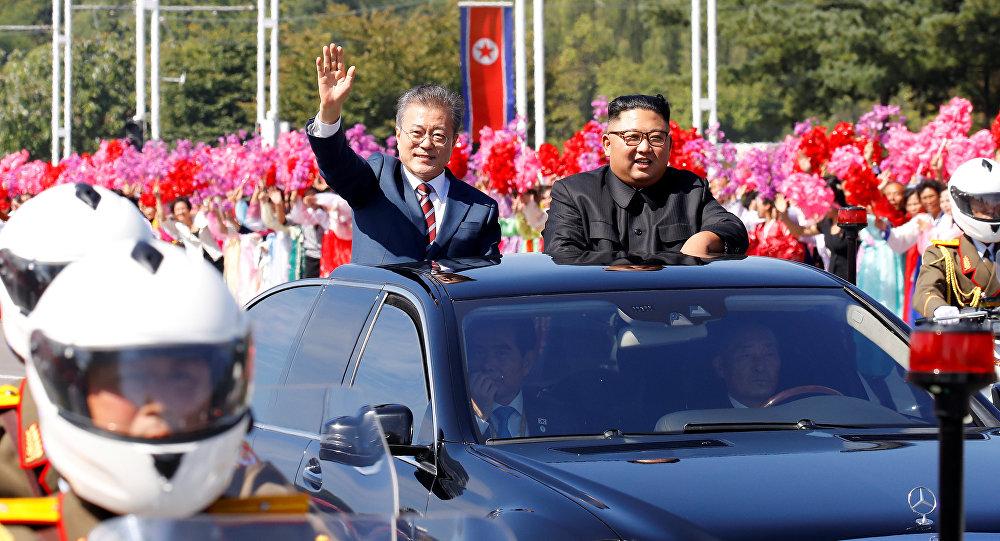 South Korean President Moon Jae-in and North Korean leader Kim Jong Un wave during a car parade in Pyongyang, North Korea, September 18, 2018