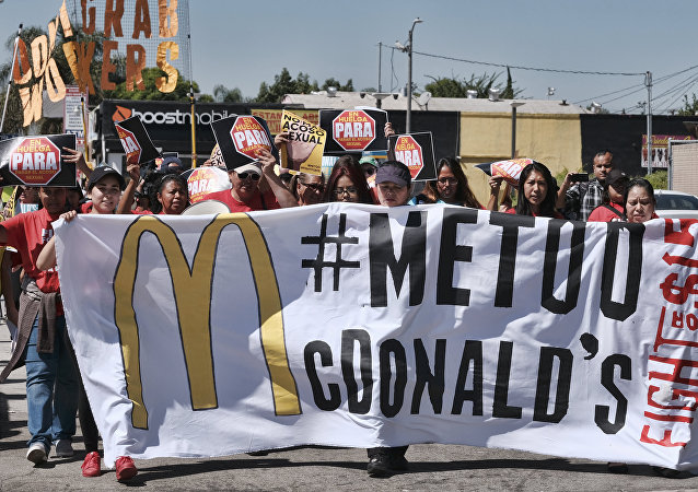 McDonald's workers carry a banner and march towards a McDonald's in south Los Angeles on Tuesday, Sept. 18, 2018.