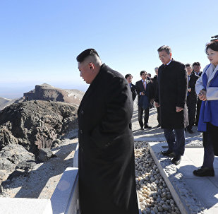 South Korean President Moon Jae-in, second from left, and his wife Kim Jung-sook, second from right, North Korean leader Kim Jong Un, left, and his wife Ri Sol Ju, right, visit Mount Paektu