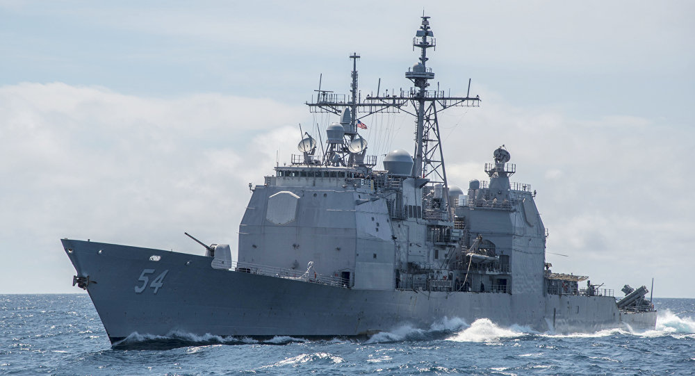 "This Mar. 6, 2016, file photo provided by the U.S. Navy, shows the Ticonderoga-class guided-missile cruiser USS Antietam (CG 54) sails in the South China Sea. China says it dispatched warships to identify and warn off a pair of U.S. Navy vessels sailing near one of its island claims in the South China Sea. A statement on the Defense Ministry's website said the Arleigh Burke class guided-missile destroyer USS Higgins and Ticonderoga class guided-missile cruiser USS Antietam entered waters China claims in the Paracel island group ""without the permission of the Chinese government."""