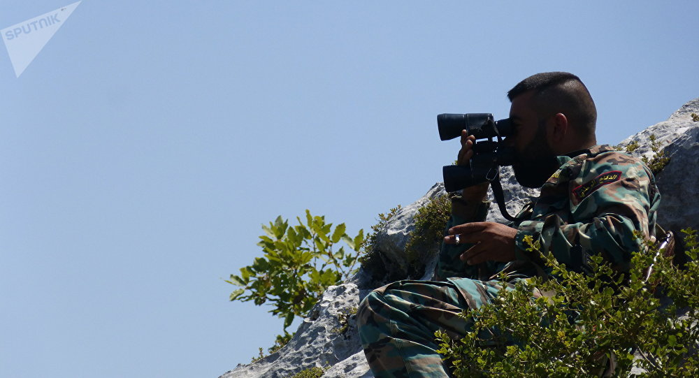 Syrian soldier chilling on a hilltop with a cigarette as he monitors artillery strikes against militant positions in Latakia.