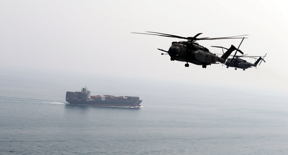 U.S. Navy MH-53E Sea Dragon helicopters are seen making their way to an exercise area as they take part in a U.S. and U.K. Mine Countermeasures Exercise (MCMEX) taking place at the Arabian Sea, as a cargo ship is seen sailing towards Straits of Harmoz, September 10, 2018