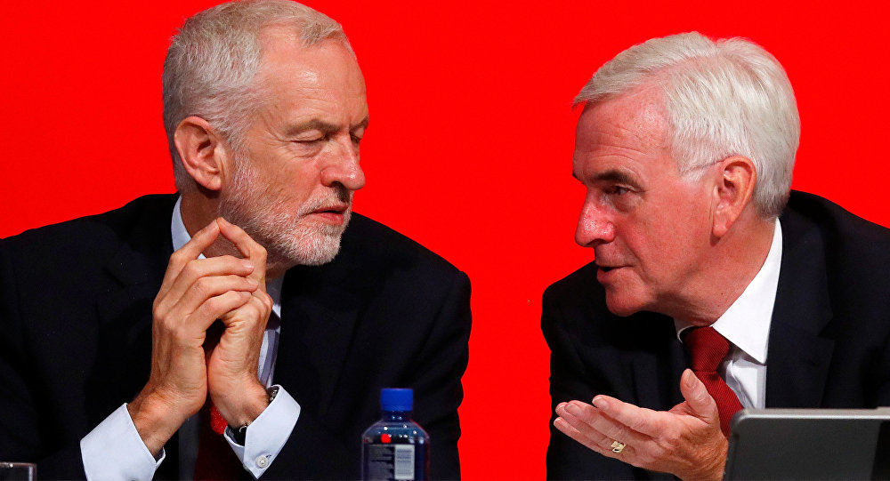 The Labour Party's shadow Chancellor of the Exchequer John McDonnell speaks to party leader Jeremy Corbyn at the party's conference in Liverpool, Britain, September 24, 2018.