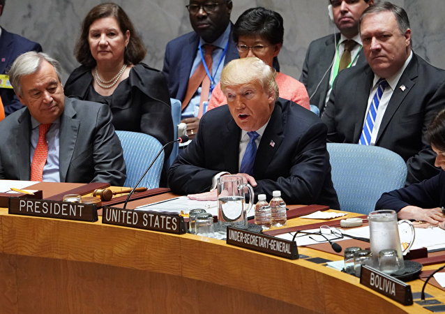 UN General Secretary Antonio Guterres listens as US President Donald Trump (C) opens the UN Security Council meeting on September 26, 2018 in New York on the sidelines of the UN General Assembly