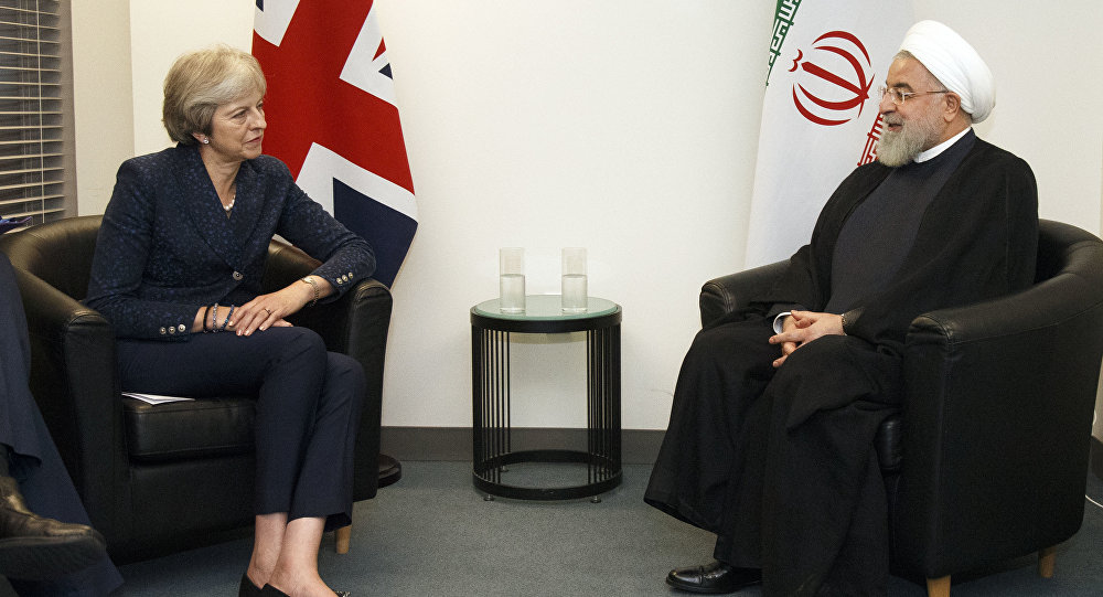 British Prime Minister Theresa May meets with Iranian President Hassan Rouhani on the sidelines of the 73rd session of the United Nations General Assembly at U.N. headquarters, Tuesday, Sept. 25, 2018.