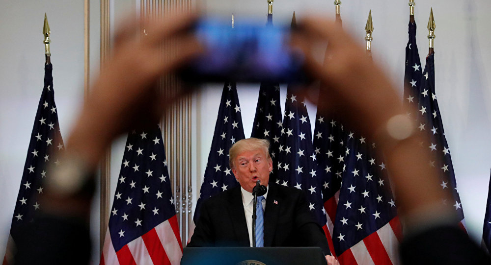 A reporter uses his mobile phone to record U.S. President Donald Trump at a news conference on the sidelines of the 73rd session of the United Nations General Assembly in New York, U.S., September 26, 2018