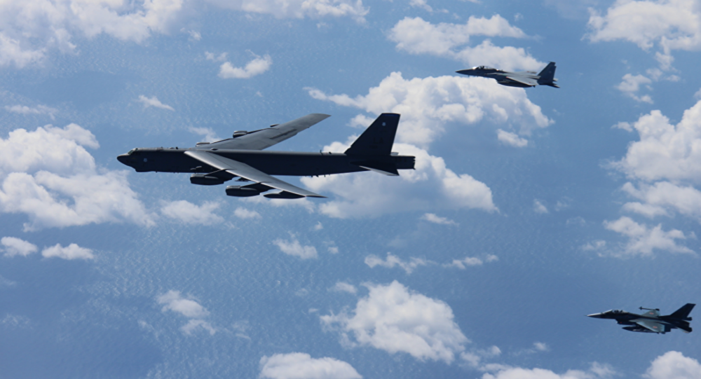 American B-52 bombers conducts bilateral training mission with 12 Koku Jieitai F-15s and 4 F-2s with the Japan Air Self-Defense Force
