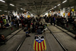 Catalan separatist protesters block the tracks of high speed train as they mark the first anniversary of Catalonia's banned independence referendum in Girona, Spain, October 1, 2018