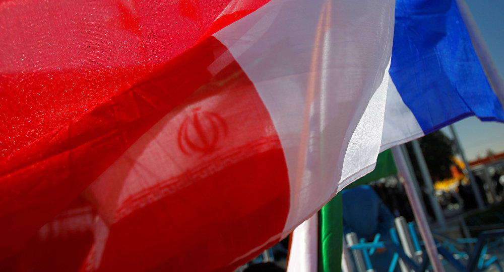 France national flag flutters as an Iranian flag is seen behind (File)