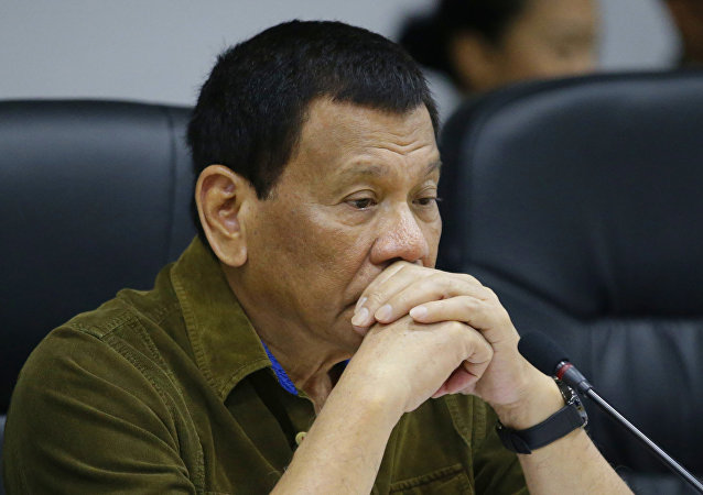 Philippine President Rodrigo Duterte attends a command conference at the National Disaster Risk Reduction and Management Council operations center in metropolitan Manila, Philippines on Thursday, Sept. 13, 2018