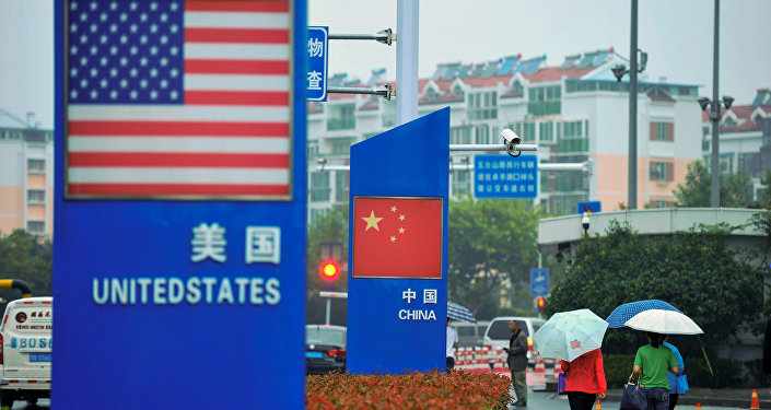 Signs with the US flag and Chinese flag are seen outside a store selling foreign goods in Qingdao in China's eastern Shandong province on September 19, 2018