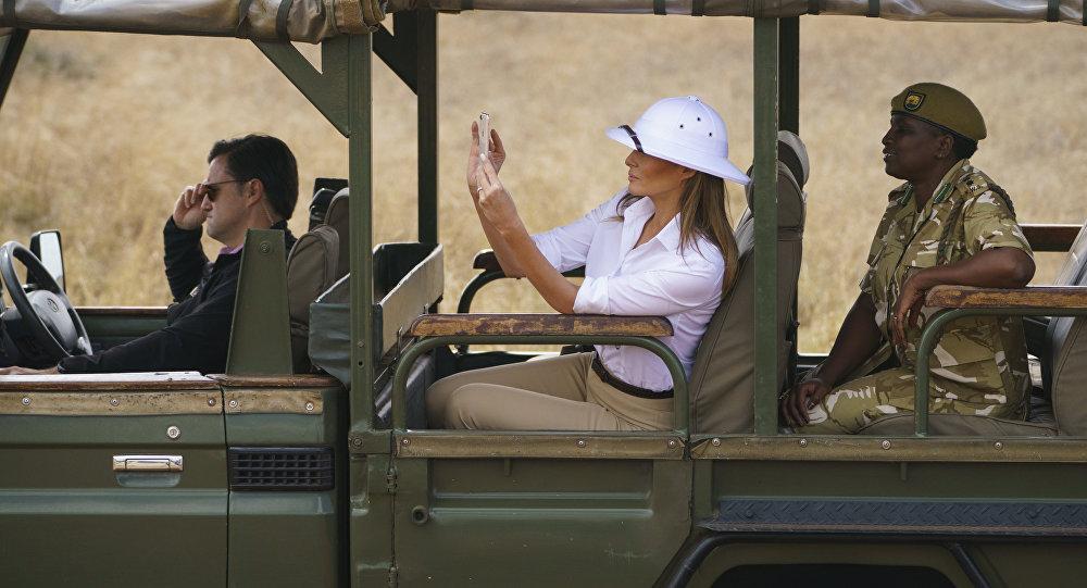 First lady Melania Trump takes photos with her cell phone during a safari at the Nairobi National Park in Nairobi, Kenya, Friday, Oct. 5, 2018