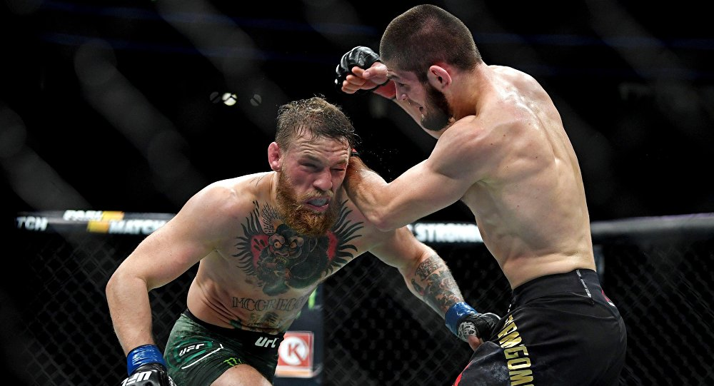 Khabib Nurmagomedov (red gloves) fights Conor McGregor (blue gloves) during UFC 229 at T-Mobile Arena in Las Vegas, Oct. 6, 2018