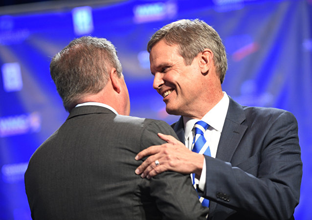 Tennessee gubernatorial candidates Democrat Karl Dean, left, and Republican Bill Lee greet each other at the start of a debate.