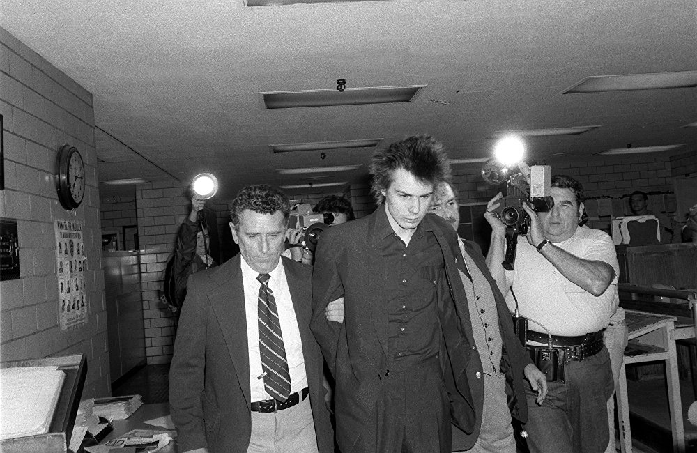 Sid Vicious, under arrest for the murder of his American girlfriend Nancy Spungen in October 1978