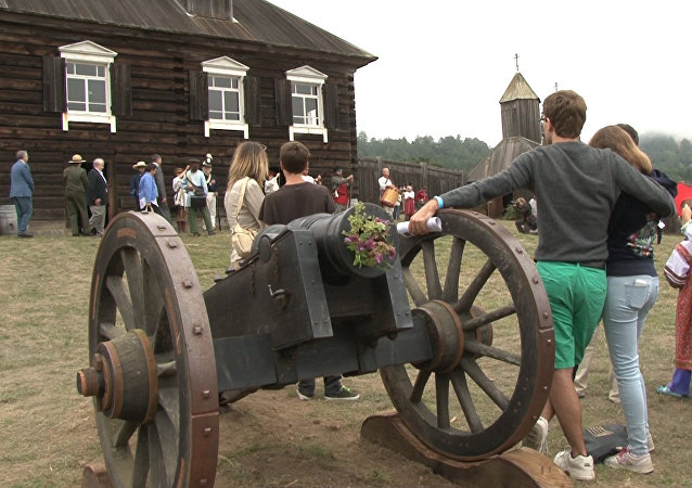 Visitors inside Fort Ross, with the wooden church in the background, on July 28, 2013, to celebrate the 201st anniversary of the creation of the Russian settlement in California.