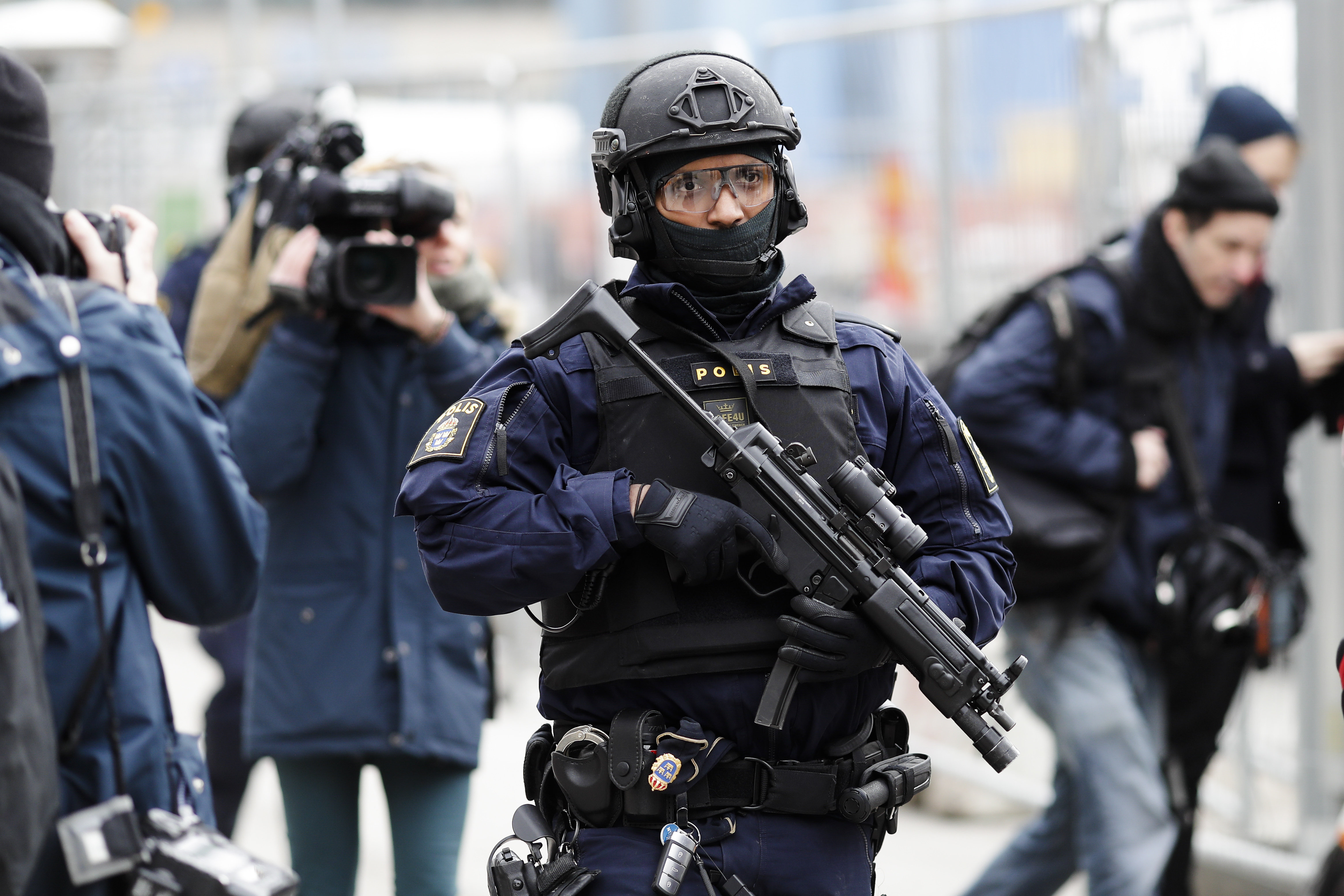 A special force police officer patrols near the department store Ahlens following a suspected terror attack on the Drottninggatan street in central Stockholm, Sweden, Saturday, April 8, 2017