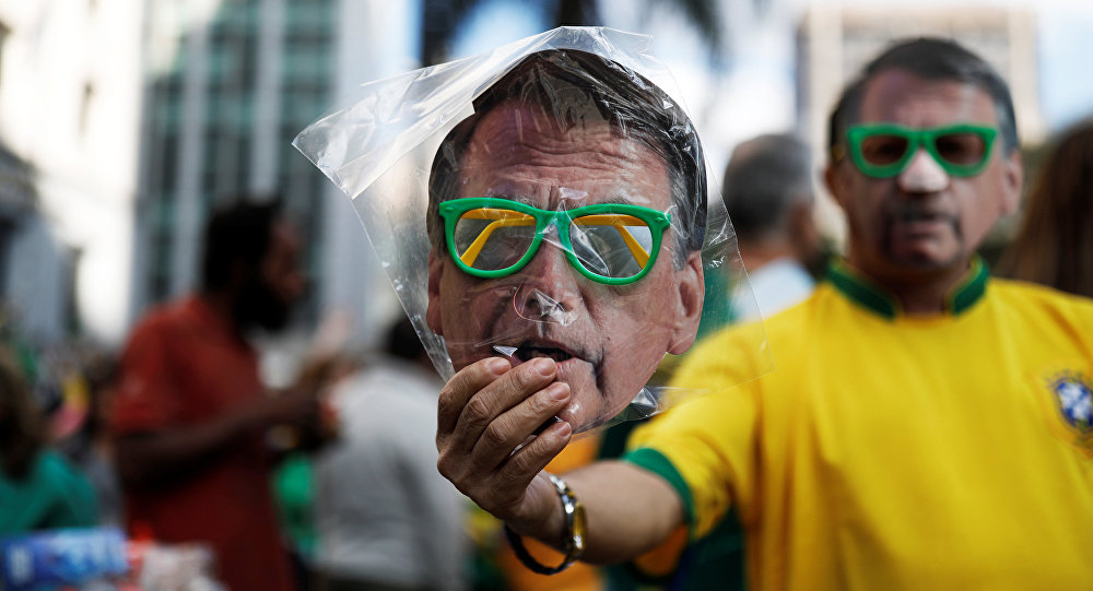 A street vendor sells a mask of Jair Bolsonaro