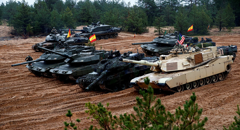 U.S., German, Spanish and Polish troops of the NATO enhanced Forward Presence battle goups with their tanks get ready for the Iron Tomahawk exercise in Adazi, Latvia October 23, 2018