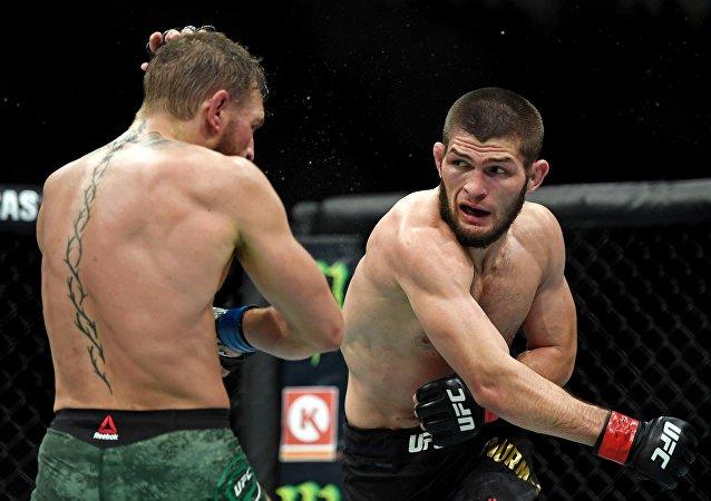 Oct 6, 2018; Las Vegas, NV, USA; Khabib Nurmagomedov (red gloves) fights Conor McGregor (blue gloves) during UFC 229 at T-Mobile Arena