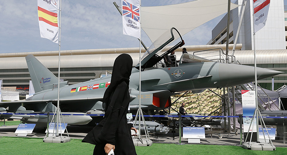 A woman walks past a Eurofighter Typhoon aircraft on display at a military show launching the International Defence Exhibition and Conference (IDEX) at the Abu Dhabi National Exhibition Centre in the Emirati capital on February 17, 2013
