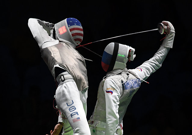 US Gerek Meinhardt (L) competes against Russia's Artur Akhmatkhuzin during the men's team foil semi-final bout between Russia and US as part of the fencing event of the Rio 2016 Olympic Games, on August 12, 2016, at the Carioca Arena 3, in Rio de Janeiro
