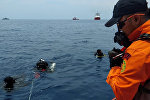 Rescue workers are seen at the site where it is believed the Lion Air flight JT610 crashed, that took off from Jakarta and crashed into the sea, Indonesia October 29, 2018 in this image obtained from social media