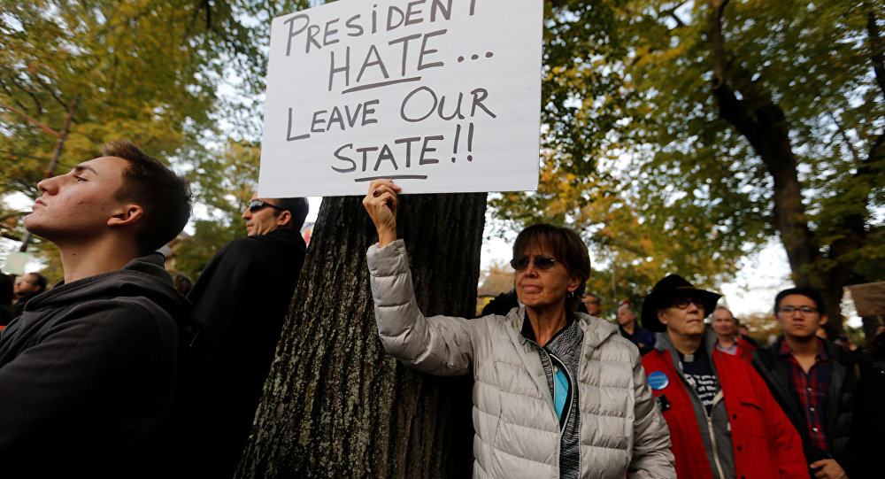 A participant in the march in memory of the victims of the Tree of Life Synagogue shooting, holds a sign opposing U.S. President Donald Trump, in Pittsburgh, Pennsylvania, U.S., October 30, 2018.