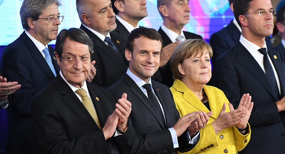 Germany's Chancellor Angela Merkel (2R), France's President Emmanuel Macron (2L), Netherland's Prime minister Mark Rutte (R) and Cyprus' President Nicos Anastasiades (1st-L) attend a ceremony on the Permanent Structure Cooperation (PESCO) on the margin of the first day of a European union summit in Brussels on December 14, 2017.