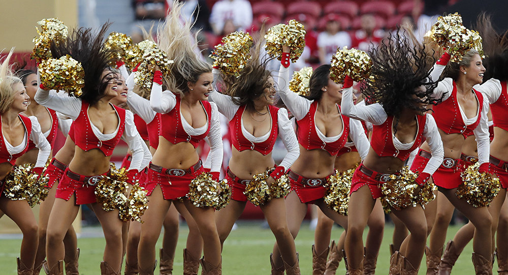 Cheerleader for NFL's San Francisco 49ers kneels during national anthem