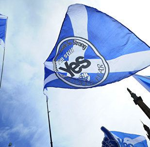 Pro-Scottish Independence supporters with Scottish Saltire flags rally in George Square in Glasgow, Scotland on July 30, 2016 to call for Scottish independence from the UK.