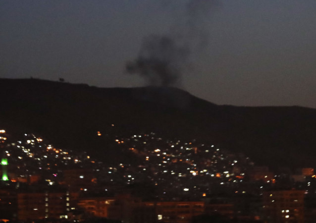 Smoke rises after airstrikes targeting different parts of the Syrian capital Damascus, Syria