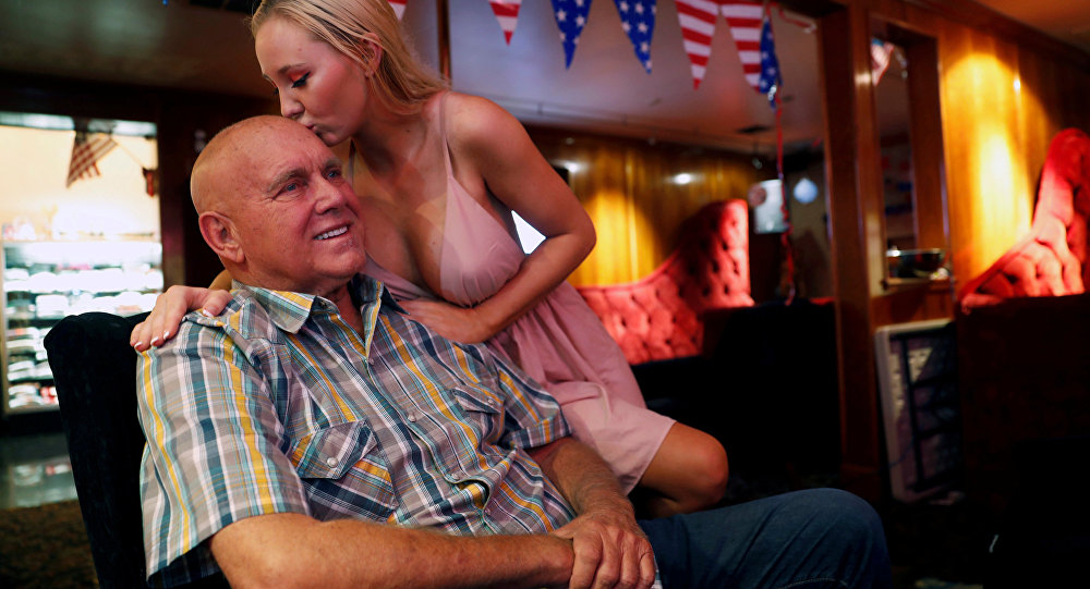 Dennis Hof gets a kiss from Misty Matrix, his girlfriend and a legal prostitute, at his Moonlite BunnyRanch legal brothel in Mound House, Nevada