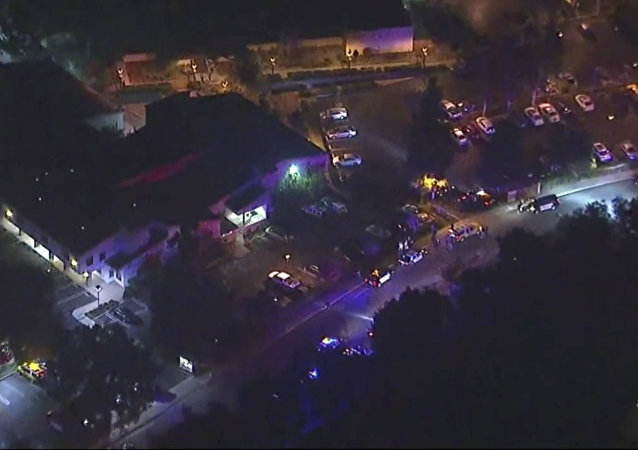 In this image made from aerial video, police vehicles line a road in the vicinity of a shooting in Thousand Oaks, California, early Thursday, Nov. 8, 2018