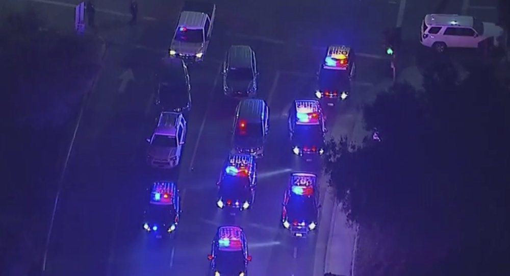 In this image made from aerial video, police vehicles block an intersection in the vicinity of a shooting in Thousand Oaks, California, early Thursday, Nov. 8, 2018