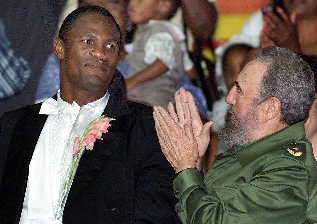 Felix Savon, pictured with the late Cuban leader Fidel Castro, was a huge hero in Cuba for his accomplishments in boxing