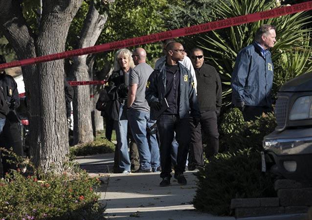 FBI investigators arrive outside the house of David Ian Long, the identified shooter in Wednesday's attack on a country music bar in Southern California, as they wait to search the residence on Thursday, Nov. 8, 2018, in Newbury Park, Calif.